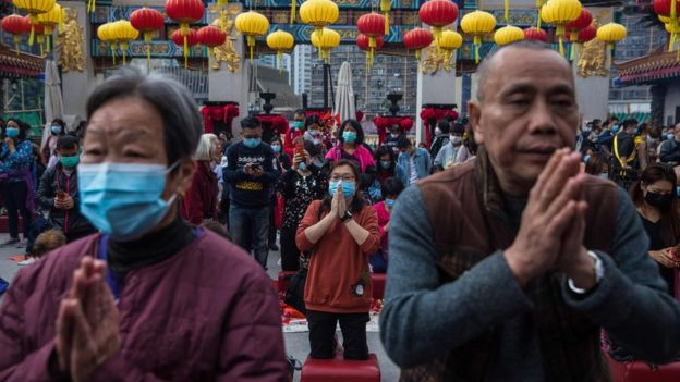 In Hong Kong's Wong Tai Sin temple, people welcome the new year in masks