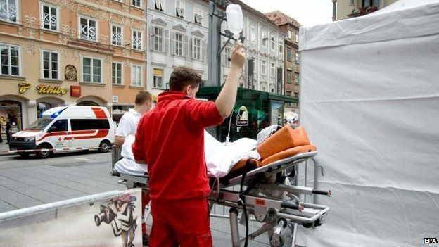 Paramedics treat a person at the scene where an SUV drove into pedestrians in the city center of Graz, Austria, 20 June 2015
