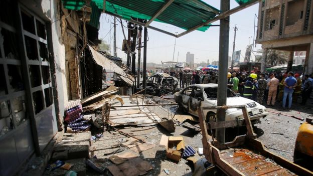 Damaged shops are seen at the site of car bomb attack near a government office in the Karkh district of Baghdad (30 May 2017)