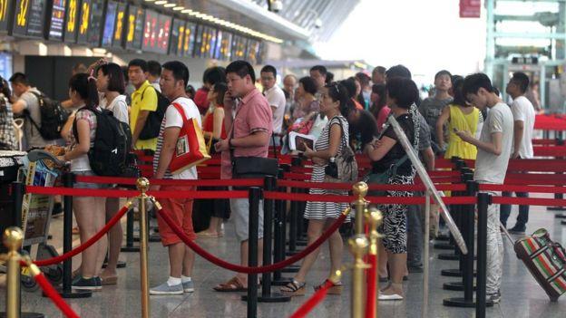 Chinese travellers at Zhengzhou Xinzheng International Airport in Zhengzhou, central China