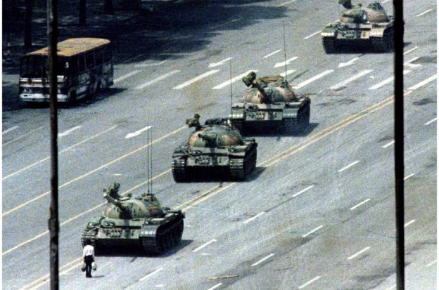 A Beijing citizen stands in front of tanks on the Avenue of Eternal Peace in this June 5, 1989 file photo during the crushing of the Tiananmen Square uprising. June 4 marks the 25th anniversary of the suppression of pro-democracy protests in Tiananmen Square in 1989. Picture taken June 5, 1989. REUTERS/Stringer/Files