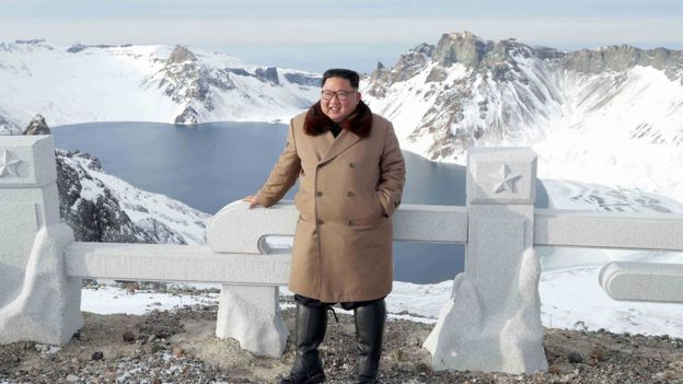 An undated picture released by North Korea's official Korean Central News Agency (KCNA) on 4 December, 2019 shows North Korean leader Kim Jong-un posing as he visits battle sites at Mount Paektu, Ryanggang