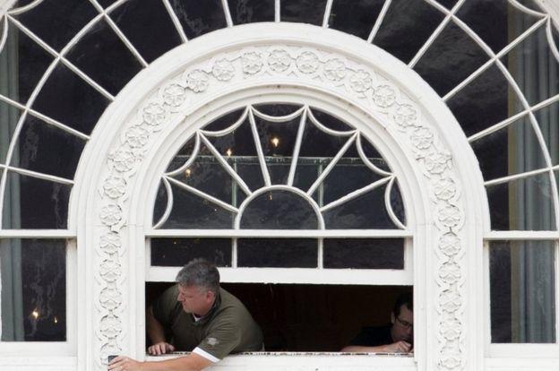 a worker fixes windows