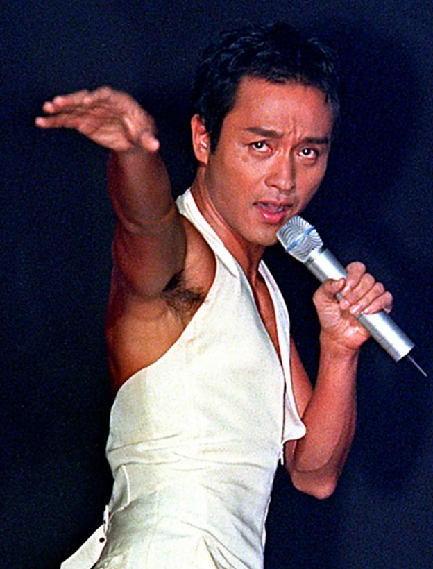 Hong Kong's king of pop, singer Leslie Cheung performs on the stage during a concert at Shanghai Stadium late 16 September 2000