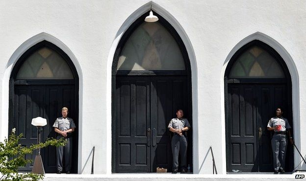 """Sheriff""""s deputies guard the entrance to the Emanuel AME Church in Charleston, South Carolina during Sunday services - 21 June 2015"""