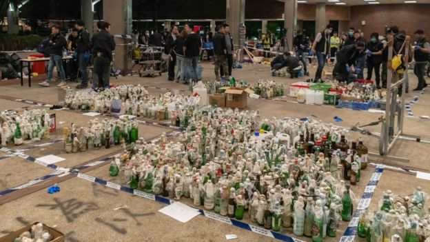 Police inspecting petrol bombs