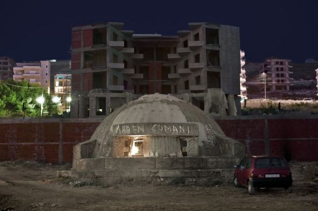 Bunker in Albania next to buildings