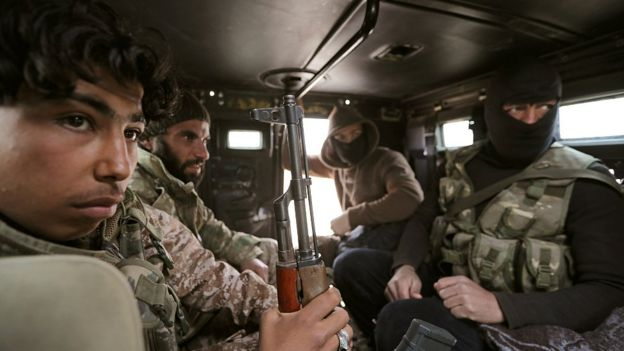 Turkey-backed Free Syrian Army fighters are seen in their vehicle in al Ajami village in east al Bab, Syria February 3,2018