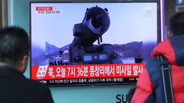 Television news coverage showing archive footage of a North Korean missile launch is broadcast on a public screen in Seoul on March 6, 2017.