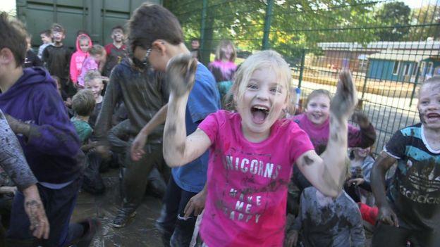 Children following a mud run