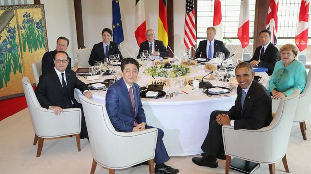 Japanese Prime Minister Shinzo Abe, U.S. President Barack Obama, German Chancellor Angela Merkel, Italian Prime Minister Matteo Renzi, European Council President Donald Tusk, European Commission President Jean-Claude Juncker, Canadian Prime Minister Justin Trudeau, British Prime Minister David Cameron and French President Francois Hollande pose for a photo during a working lunch at a previous G7 meeting