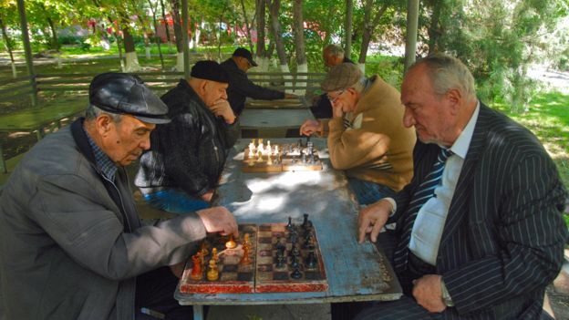 Old men playing chess in the park in Armenia