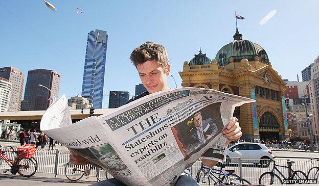 Newspaper reader in Melbourne, Australia