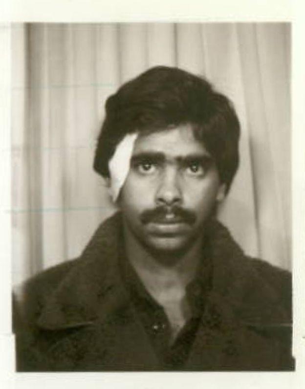 Suresh Grover passport photo, with bandaged wound
