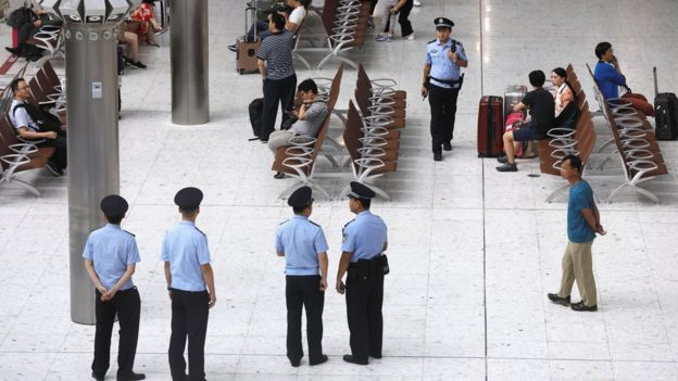 Chinese policemen stand guard at mainland's jurisdiction inside West Kowloon Terminus at the first day of service of the Hong Kong Section of the Guangzhou-Shenzhen-Hong Kong Express Rail Link, in Hong Kong, China September 23, 2018.