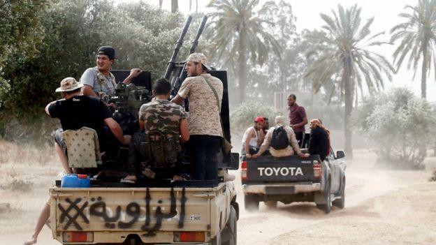 Armed militiamen on trucks in Tripoli, Libya - June 2019