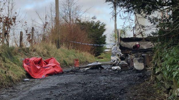 Police at the scene of the caravan fire in Ffair Rhos