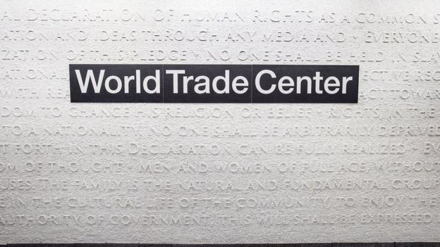 White marble mosaic covers the wall around the sign World Trade Center