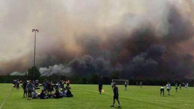 The fire seen from a football match in Barden Ridge, one of the affected suburbs