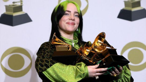 Billie Eilish with her haul of Grammy Awards