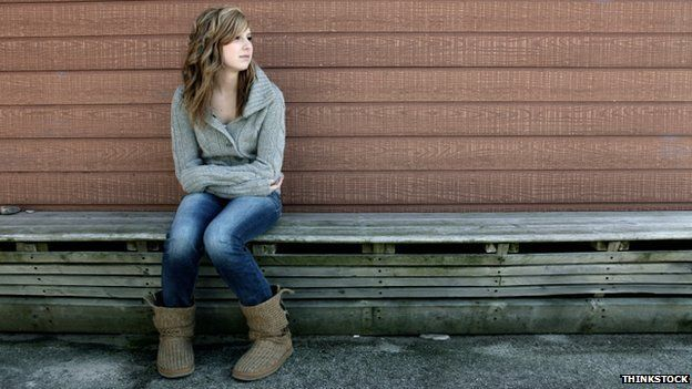 Lonely girl on bench