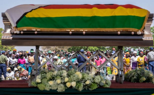 Mugabe finally buried in his village