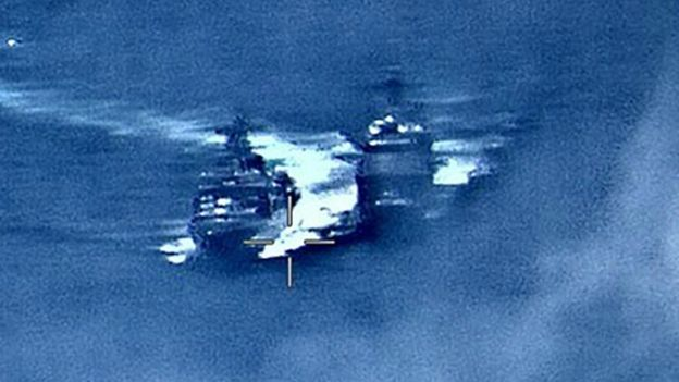 US Navy image on June 7, 2019, shows the Russian anti-submarine ship Admiral Vinogradov (L) sailing close to the USS Chancellorsville