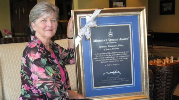 Lynette Silver with a framed copy of her certificate saying Minister's Special Award, which she was awarded by government authorities in Sabah, Malaysia
