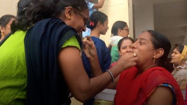 Women feeding sweets to each other