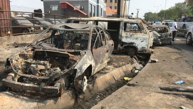 Car and bus wey burn for di fire