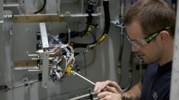 Technician checking equipment