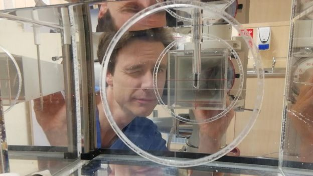 Mark Long looking through laboratory equipment