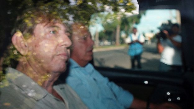 """Brazilian spiritual healer Joao Teixeira de Faria, known as """"John of God"""", arrives at a the police station a day after being officially ruled a fugitive"""
