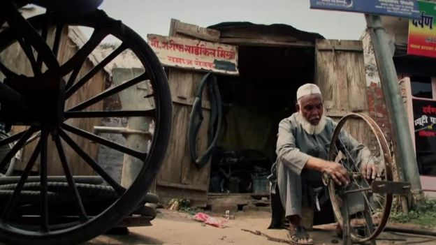 Mohammad Shareef reapairing a cycle wheel
