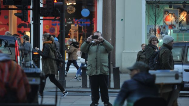 Surveillance image of Lewis Ludlow taking pictures in Oxford Street