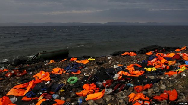 Dinghies and and life jackets are left scattered by new arrivals in Greece