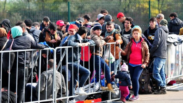 Migrants at a reception centre in Petisovci, Slovenia, on 18 October 2015