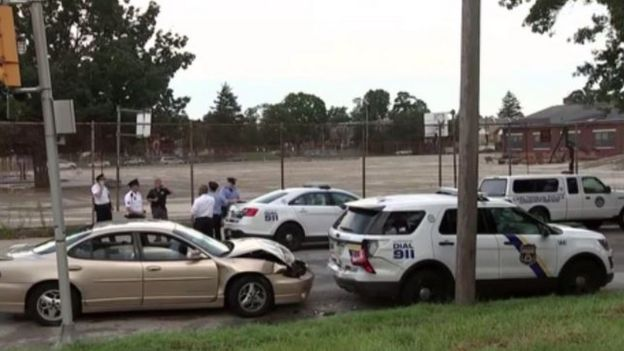 A car is crashed into a police car