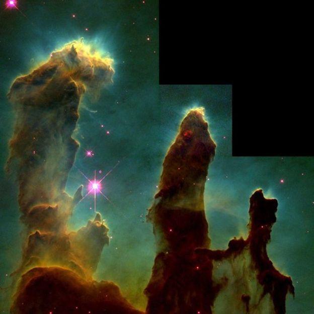 Colunas de gás e poeira durante o processo de formação de estrelas na Nebulosa da Águia