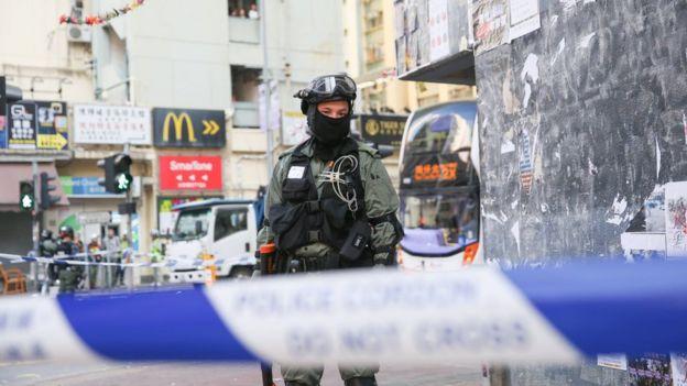 Police guard the scene where the protester was shot