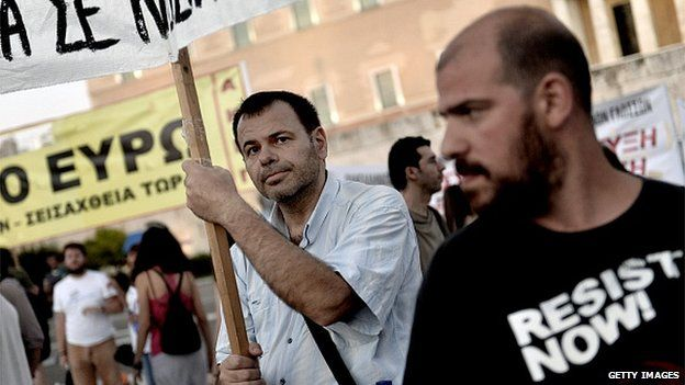 Protesters demonstrate outside the Greek parliament in Athens on 22 July, 2015