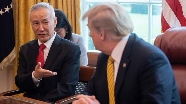 China's Vice Premier Liu He (L) speaks with US President Donald Trump during a trade meeting in the Oval Office at the White House in Washington, DC, on April 4, 2019