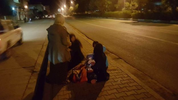 Three Baghdad residents in the streets after a powerful earthquake struck