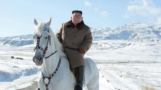 North Korean leader Kim Jong Un riding a white horse amongst the first snow at Mouth Paektu.