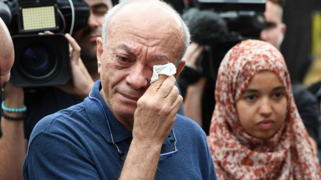 Saeed Maasarwe wipes away tears while talking to media at a public vigil for his daughter