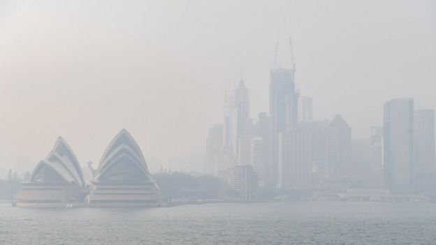 Sydney Opera House and skyline obscured by the smoke