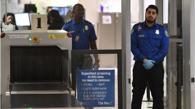 Transportation Security Administration officers (TSA) stand on duty at the departure area of the Los Angeles International Airport in Los Angeles, California, on 5 January, 2019. - TSA staff are taking sick leave in record numbers since the partial government shutdown forced them to work without pay began on Deember 22, 2018.