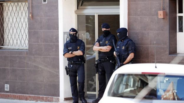 Police guard the home of an alleged attacker in Cornellà de Llobregat