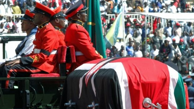 Military officers escort a gun carriage carrying the coffin of Daniel Arap Mo