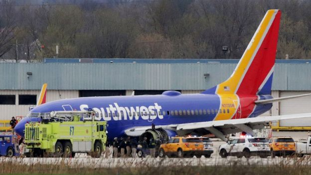A Southwest Airlines Boeing 737-700 jet on the runway at Philadelphia International Airport after it was forced to land with an engine failure on 17 April, 2018. A catastrophic engine failure killed one person and forced an emergency landing